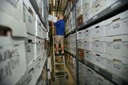 Anthony Guardiola, warehouse/operations, pulling files in the buildings older section.