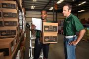 David Boler, warehouse technician and Robert Kantor, co-owner of Suncoast Coffee Service and Vending, review coffee inventory.