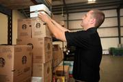 Jason Sluka, co-owner, checking coffee inventory at Suncoast Coffee Service and Vending.