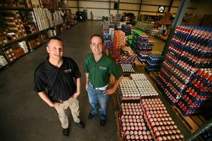 Jason Sluka and Robert Kantor, co-owners of Suncoast Coffee Service and Vending, in the warehouse.