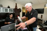 Jeff Sardisco, chief operating officer of USA Mobile Drug Testing, and Bob Klein, executive vice president, with a DOT-approved evidential breath alcohol tester.