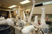 Jack Feuker, orthotic technician for Westcoast Brace & Limb, in the modification room of the central fabrication lab.