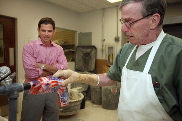 At Westcoast Brace & Limb, Greg Bauer, president, watches as Jack Feuker, orthotic technician, makes a plaster cast mold in the modification room for a child's ankle orthosis, then applies the covering of the patient's choice.
