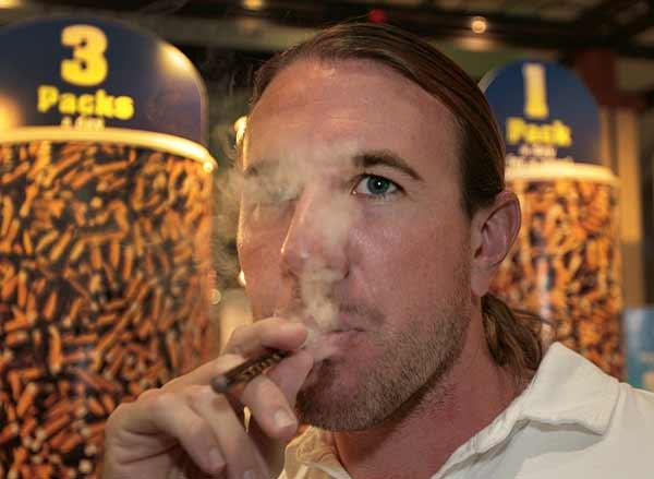 White Cloud Cigarettes' Co-partner Matthew Steingraber demonstrates the product.