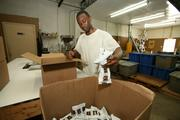 Walter Bouiye, shipping and receiving, packages coffee for shipping.