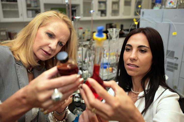 Deborah Duffey, president, of Dermazone Solutions in St. Petersburg and Berenice Sauza, a supervisor, evaluate clarity and stability of a lyphazome incapsulated solution in the annalytical lab.
