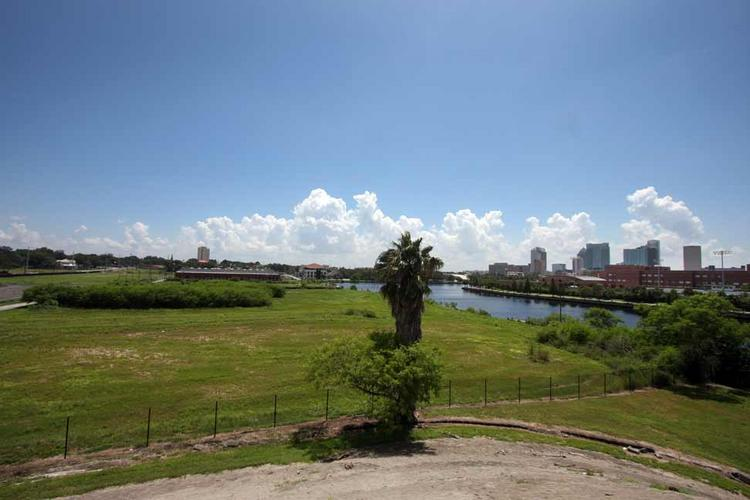 Tampa Heights property, 77 vacant acres, viewed from the North Boulevard bridge. Blake High School and downtown Tampa are at right.