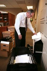 Gray Robinson law firm moving to a new location in the SunTrust  building in downtown Tampa. Robert Johnson, partner, looking through boxes and new file drawers.