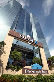 Former One Sarasota Tower is now Chase Tower with plasma TV's, private client rooms, Chase mortgage bankers and self service banking kiosks.