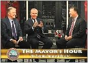 Jack Harris, 970 Radio personality, left, and Mayor Bob Buckhorn interviewed Timothy Roberts, Savtira CEO, in September.