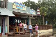 O'Maddy's Bar and Grille kept the bar open during the storm but closed the restaurant. Businesses along Shore Boulevard South had major flooding and wind damage.