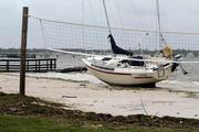 A sailboat washed onto the public beach off Boca Ceiga Bay.