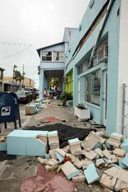 Damage to The Bamboozle gift shop on 8th Avenue in downtown Pass-A-Grille. Stores and restaurants along the street had flooding, missing roofs, structural and interior damage and no power.
