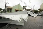 Pass-A-Grille storm damage. Here, a condo parking structure is destroyed by a tornado.