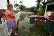 Galene Shorter, owner of Galene's Paradise Glass, Art and Jewelry shop, surveys the damage to her business.