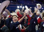 Texas delegates cheering and singing at the Republican National Convention.