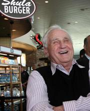 At Tampa International Airport's grand opening of new restaurants and stores media tour, former Miami Dolphins head coach Don Shula speaks to the crowd outside Shula's Bar & Grill.