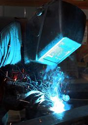 At Earthworks Environmental in Odessa, David Ross, shop manager, welds a cross bracket for a Metz Unit.