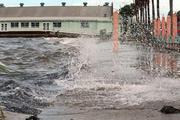 Businesses along Shore Boulevard in Gulfport had major flooding and wind damage from Tropical Storm Debby. Waves off the bay break onto the street near the Gulfport Casino.