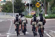 Bike police along Meridian Avenue in Channelside patrol the Republican National Convention area downtown.