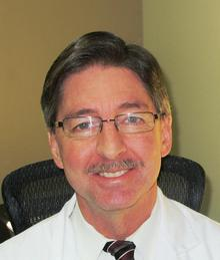 Dr. John Kevill