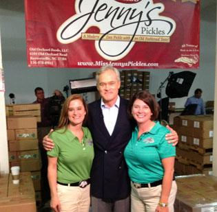 Scott Pelley of CBS News stands with Ashlee Furr, left, and Jenny Fulton of Miss Jenny's Pickles in Kernersville. Click  here for a slideshow of the company's Kernersville facility.