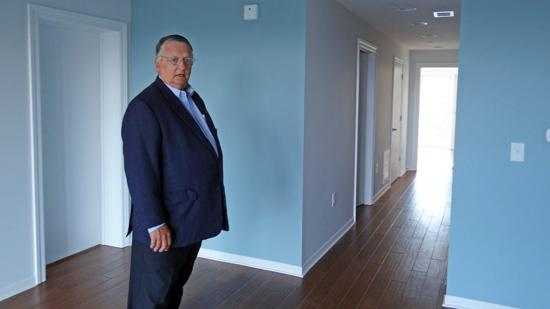 Bud Baker shows off an apartment at Hilltop House.