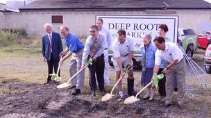 Shoveling dirt at Deep Roots Market's new home