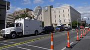News vehicles line West Market Street in downtown Greensboro, where the trial of former Sen. John Edwards is under way.