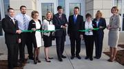 An estimated 100 people gathered as First Citizens Bank cut the ribbon on the new Irving Park branch.