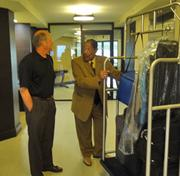 Eddie Kearney, a lobby ambassador and charter employee of the Airport Marriott, tells guest Gary Blendern of Lake Lure about the renovations.