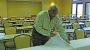 Ron Platt, who has been on staff at the Greensboro-High Point Airport Marriott since it opened in 1983, sets up for the Fastenal conference. The renovations updated the existing meeting space and added 1,000 square feet.