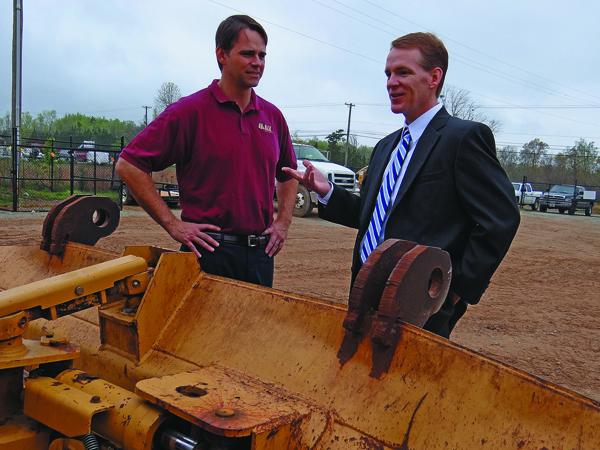 Jim Bingham, left, CEO of May Heavy Equipment, talks with Greg Higgins, an attorney with Nexsen Pruet.