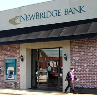 NewBridge Bank reported a third-quarter loss of $32 million, but successfully raised $56 million in new capital from investors.