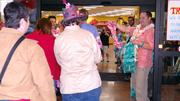 The store's crew members handed out leis to the about 500 shoppers who arrived early Monday to check out the new store.