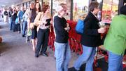 A steel drum band entertained customers who lined up early Friday morning to get inside the new Trader Joe's.