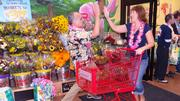 Trader Joe's crew members cheered and high-fived new customers walking into the Winston-Salem store for the first time.