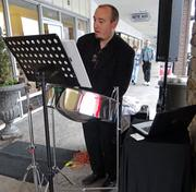 """The steel drum player entertained customers with tunes such as the classic Van Morrison hit """"Brown Eyed Girl."""""""
