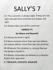 """""""Sally's 7"""" rules for positive customer interaction hang on the wall of the newly implemented customer call center, which opened in June. The call center has nine workers which handle customer service calls from retail stores and the front desk."""