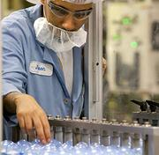 Jason Irby monitors a Secret antiperspirant production line at Proctor & Gamble's Brown Summit plant.