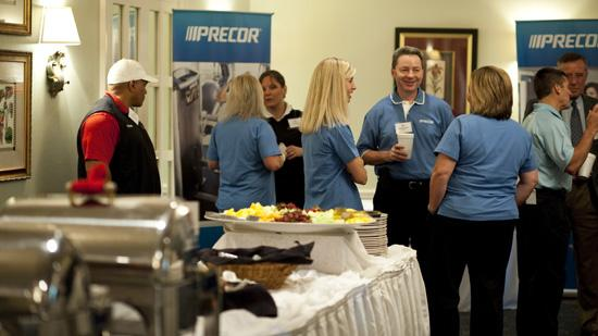 The Triad's Healthiest Employers awards program kicked of with a healthy breakfast, of course, that included fruit and turkey bacon. Pictured above are some employees from Precor, one of the event's sponsors.
