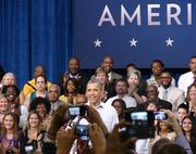 President Obama greets his audience at Guilford Technical Community College in Jamestown on Tuesday.