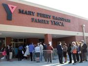 People wait to be let into the Mary Perry Ragsdale YMCA in Jamestown to hear President Barack Obama speak on Tuesday.