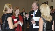 Doug Copeland, the president and publisher of The Business Journal, speaks with attendees at the CFO of the Year awards ceremony.
