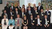The 17 CFO of the Year honorees with the event's sponsors. Front row, from left to right: Kim S. Hampton, Reynolda House Museum of American Art; Carol Anne Dernbach, Prudential Carolinas Realty; Jerry Bohnsack, Cross Company; Kelly Hasick Pinnix, Piedmont Triad Charitable Foundation; Michael B. Wainscott, Technology Crops International; Allen Liles, Carolina Bank; and Stephen Bostian, Smart Choice.Middle row, from left to right: Drew Dixon, Inmar Inc.; Robert Pompey Jr., N.C. A&T State University; Michael Kelly, Piedmont Pharmaceuticals; Eric N. Hoyle, Old Salem Museums & Gardens; Steve Henderson, Girl Scouts Carolinas Peaks to Piedmont, Inc.; Rick Hudson, TranSource, Inc.; Dan Elmer, Morehead Memorial Hospital; and Steve Woodruff, Rockingham Community College.Back row, from left to right: Gerald Hunter, Winston-Salem State University; Brad Newkirk, Dixon Hughes Goodman; Bill Ball, Frank L. Blum Construction Company; Beth Monaghan, Monaghan Group; Skip Woody, Hill, Chesson & Woody; John Fox, First Tennessee Bank; and Doug Copeland, The Business Journal.