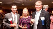 From left to right, James Mitchell of Smith Leonard, Gisela Hood and Dan Hood of HICAPS Inc., which came in at No. 2 in the Fast 50 rankings.