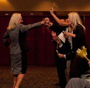 WorkForce Carolina President and CEO Teresa Lewis savors her company's success with employees at the Fast 50 awards. Her company came in at No. 4 among the Triad's fastest-growing firms.