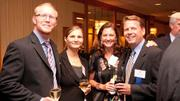 Richard and Emese Starets and Alison and Patrick Turner of Small Footprint, which ranked No. 30 among the Triad's fastest-growing companies.