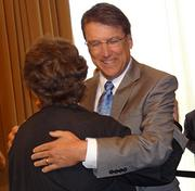 A woman greets new N.C. Gov. Pat McCrory in Greensboro on Thursday.