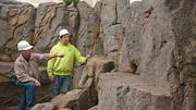 Natural Science Center Executive Director Glenn Dobrogosz, left, and Marvin Nutcher, superintendent of Cemrock, discuss a planned water feature in the fishing cat exhibit. Cemrock specializes in artificial rock environments and it is constructing, molding, carving and painting all of the environments for the new SciQuarium.